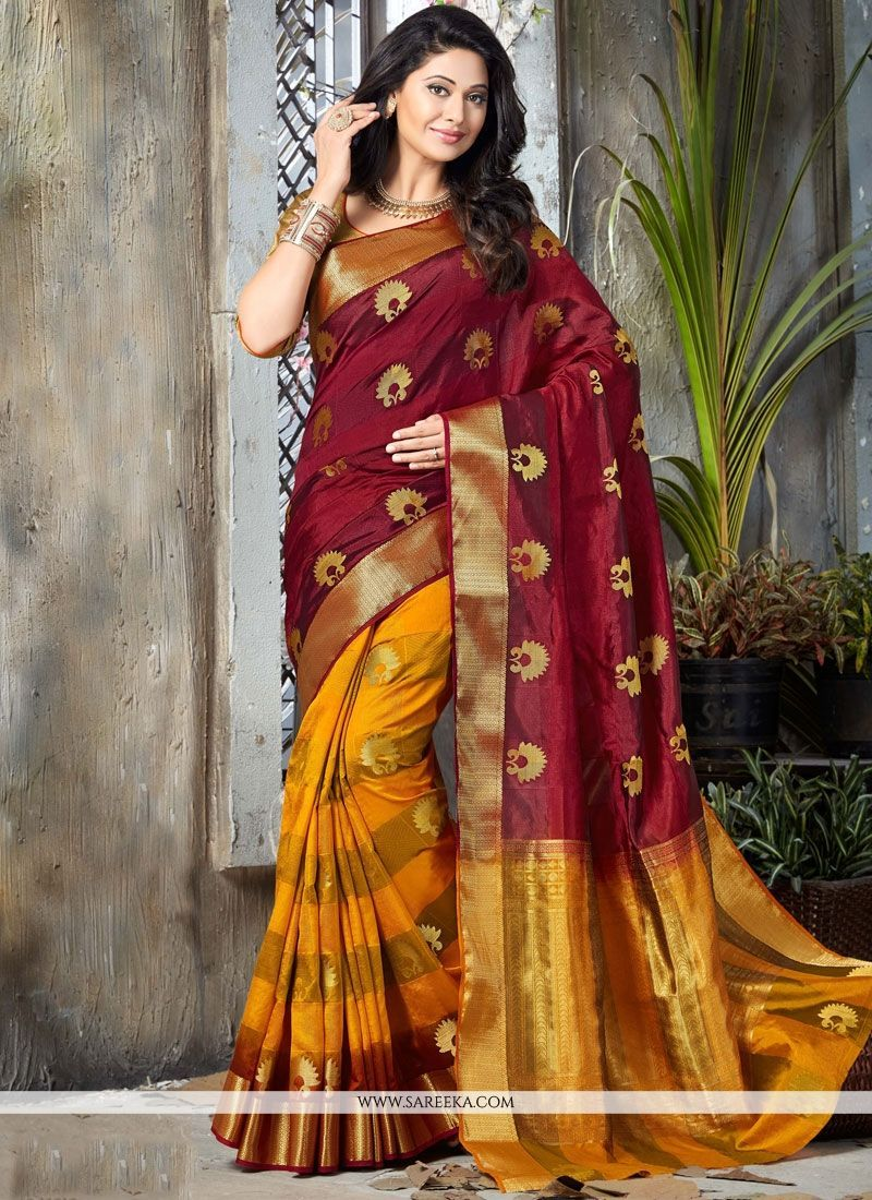 12bd8ef233 Be your own style icon with captivating maroon and yellow art silk  traditional designer saree.