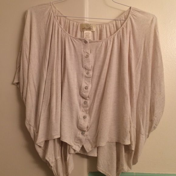 Nude low to high flowy crop top This is a nude very loose crop top that goes from low to high. The sleeves are very loose and similar to bat wings. Haven't worn in years but very comfortable and perfect for the summer Tops Crop Tops