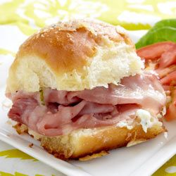 Sassy Tailgate Sandwiches --these will be a hit anywhere, anytime you make them. Hawaiian bread rolls, ham, Gruyere cheese, Philadelphia Chive & Onion Cream Cheese Spread, butter, worcestershire sauce, minced onion, & parm cheese. Sit back and enjoy the praise:)