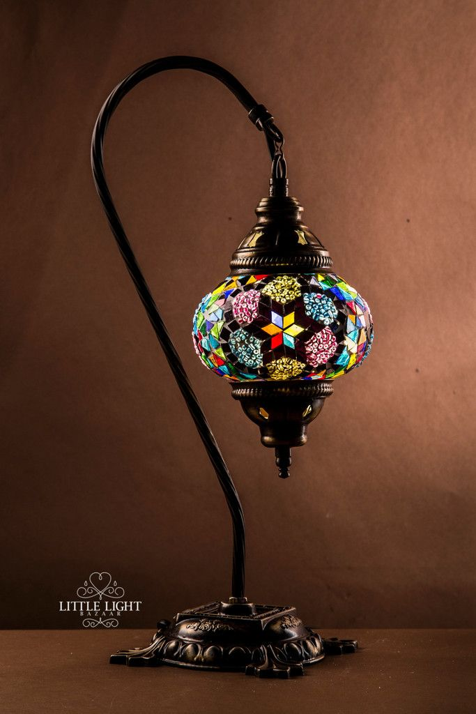 The whimsical globe on this table lamp has dark mosaic surrounded by bright floral bursts of beads. Its romantically eclectic blend of elements is as Boho chic as it is Moroccan in style. Note: This d