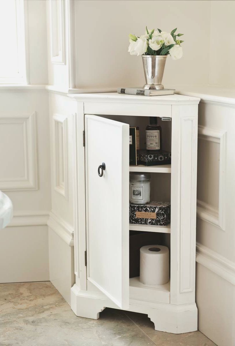 Simple White Small Corner Cabinet For Bathroom With Flwer Vase On Top Of Corner Bathroom Corner Cabinet Bathroom Floor Storage Bathroom Corner Storage Cabinet