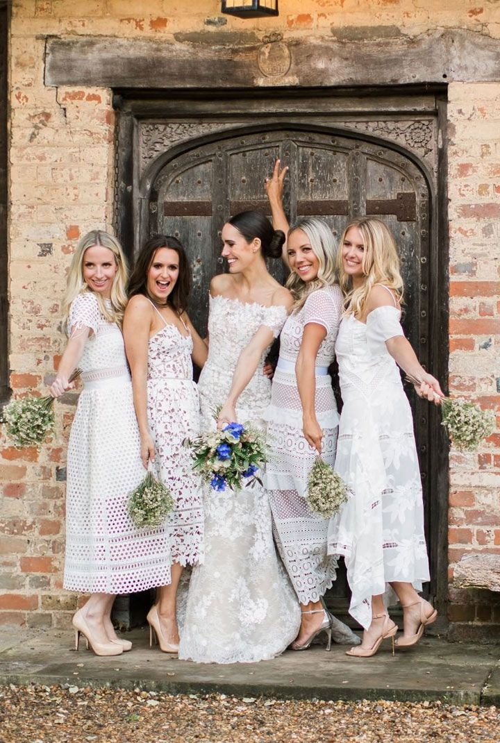 Chic all white bridal party + blue bridal bouquet and white gypsy bridesmaid's bouquet