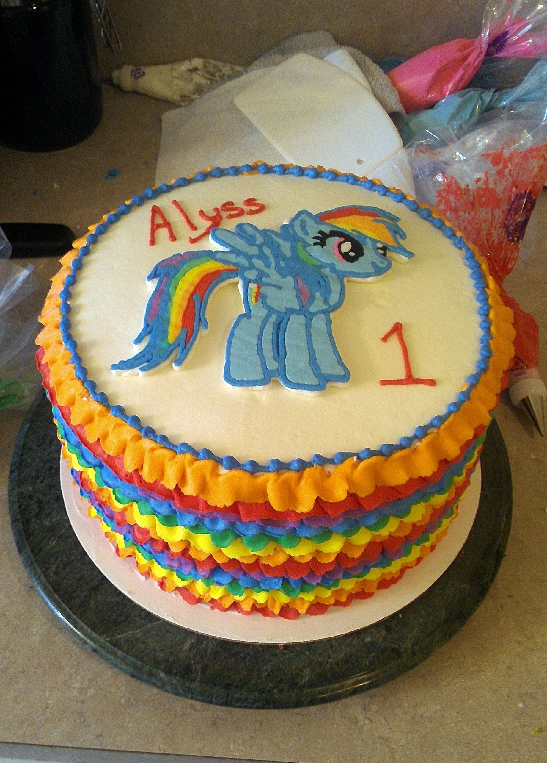 Yeeeaaaahh Rainbow Dash. This was a frozen buttercream transfer a.k.a. a lesson in how to have nerves of steel. I was certain her tail was going to snap off before I got it secured on the cake, but alas, it did not. Excuse the mess in the background, this is my real kitchen lol