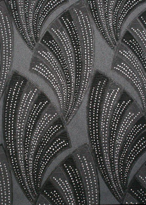 Black novella wallpaper art decor collection by graham brown this washable vinyl wallpaper is embellished with silver glitter which accentuates the