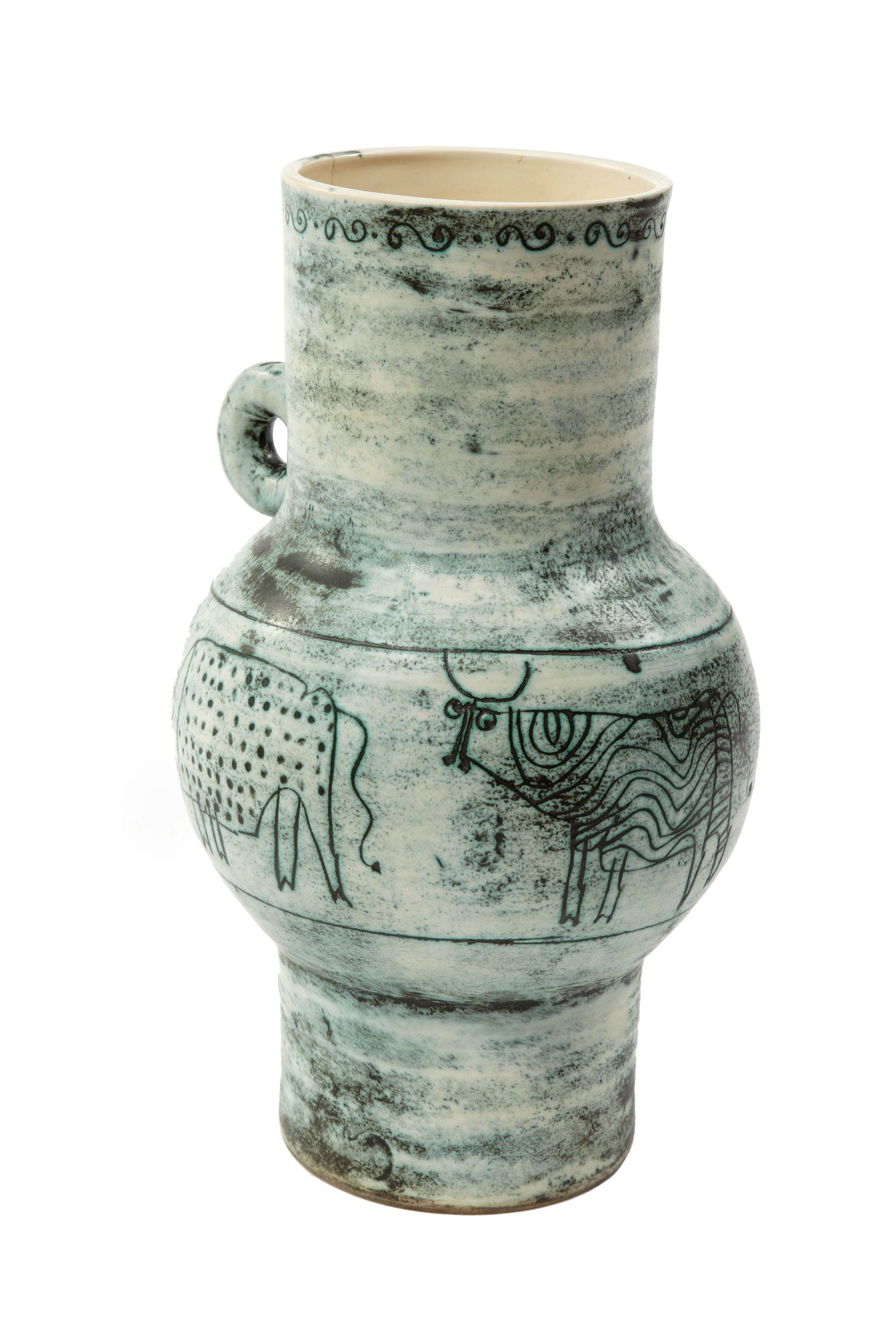 """BLIN Jacques (1920-1995) Vase  Vase en céramique à couverte blanche/verte, à une anse Décor d'une frise de vaches stylisées Signé sous la base """"J. Blin""""  H: 32.0 cm -  Sold 300 € on www.artprecium.com #Design"""