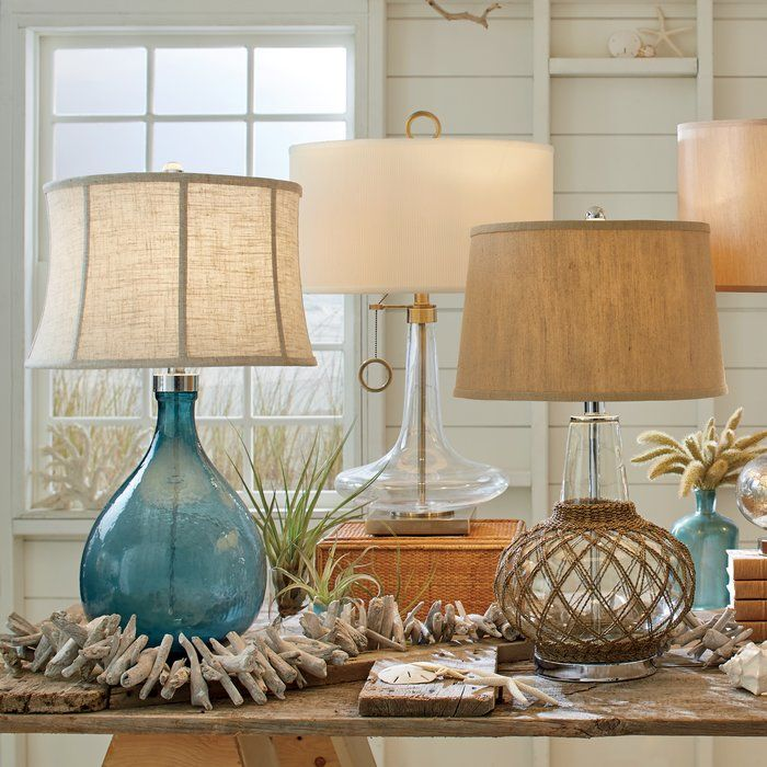 A deep azure hue makes this glass lamp a statement piece while the curved fabric shade adds drama to the silhouette.