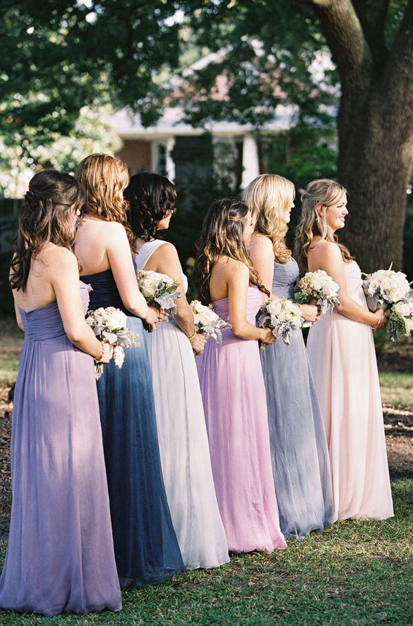 5dd9f129bb25 Bridesmaids in different purple dresses, light purple, lilac,dark purple.
