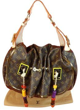 cabd9893195a Louis Vuitton Limited Edition Coated Canvas Kalahari Madonna Gm Brown Tote  New Hobo Bag. Hobo bags are hot this season! The Louis Vuitton Limited  Edition ...