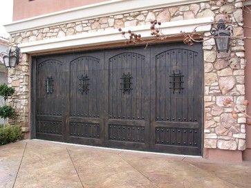 Knotty Alder Stain Custom Wood Door With Speakeasy Deco Grilles Mediterranean Garage Doors An Custom Wood Garage Doors Wood Garage Doors Garage Door Styles