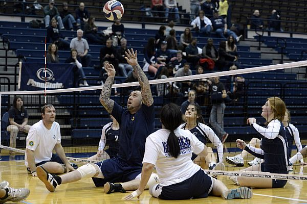 Retired Navy Aviation Electrician S Mate Steven Davis Sets A Ball For The Navy Warrior Games Volleyball Team Social Work Practice Cyber Cafe Cafe Business Plan