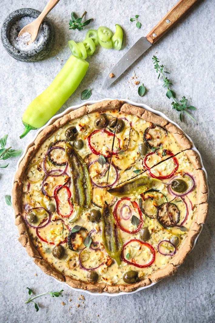 Photo of Greek quiche with vegetables and feta
