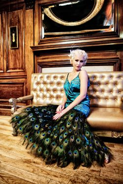 54551c5803 Peacock dress made by Lindsay Fleming Couture. The skirt is covered in  hundreds of real peacock feathers.