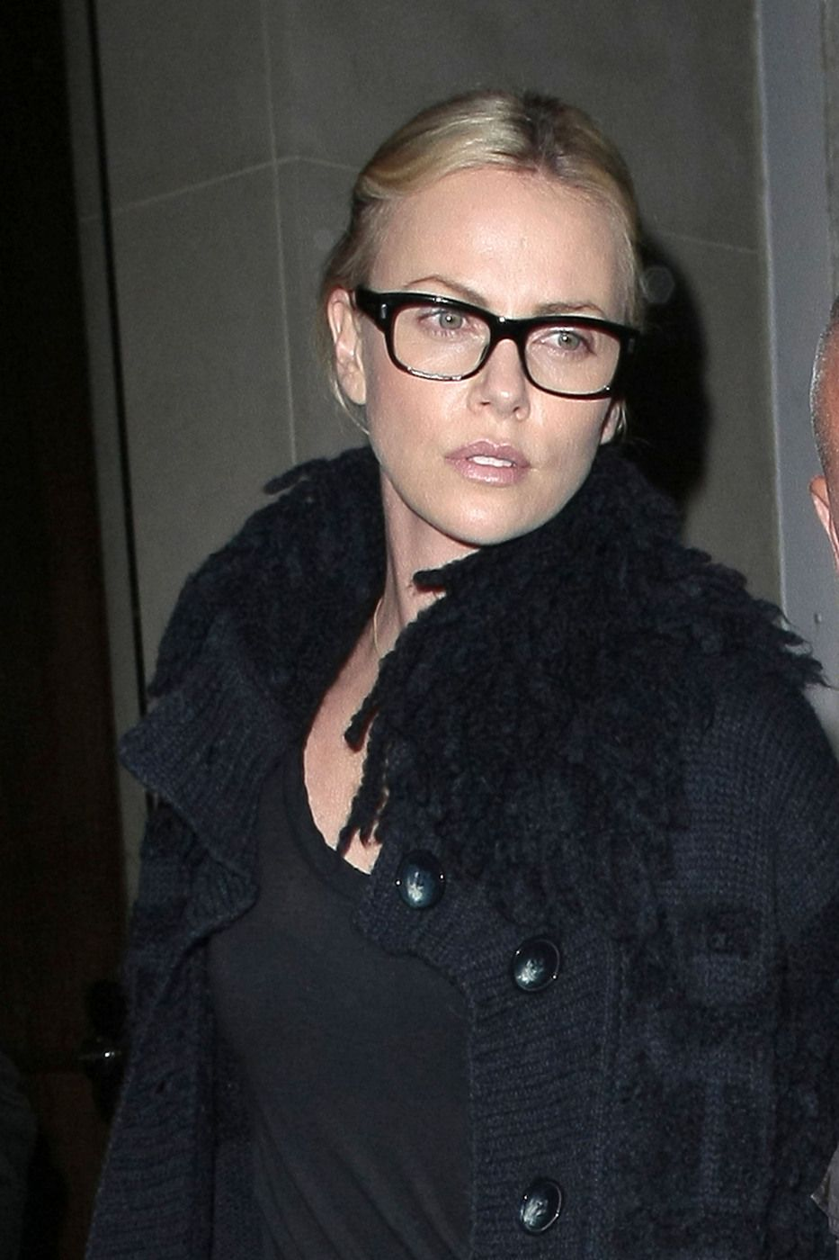 58256cd33f thick black rimmed glasses on Charlize Theron
