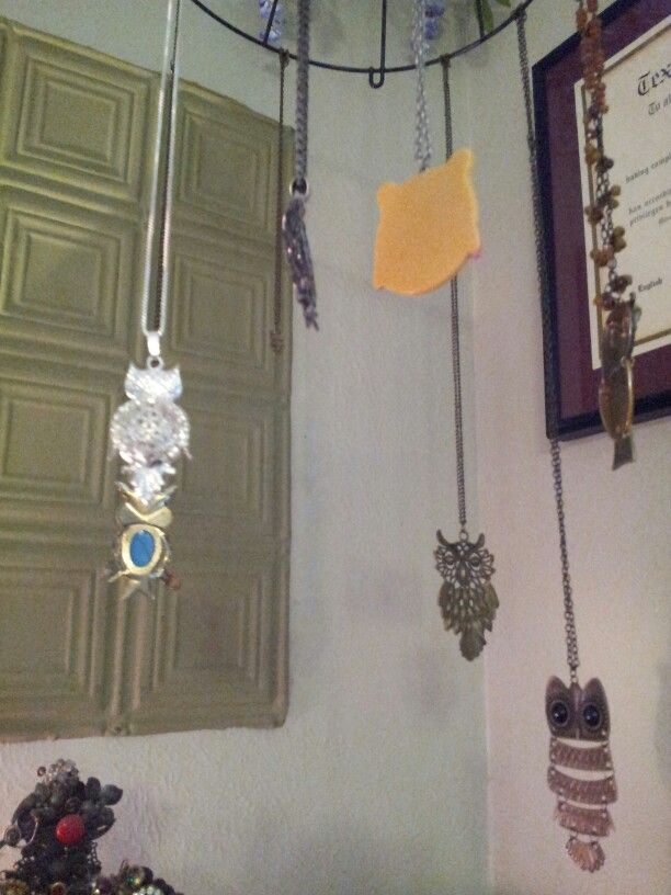 "I thought my owl necklaces deserved ""flight"" so they are hanging in a corner from an inverted planter frame. 8/31/13 LMK"