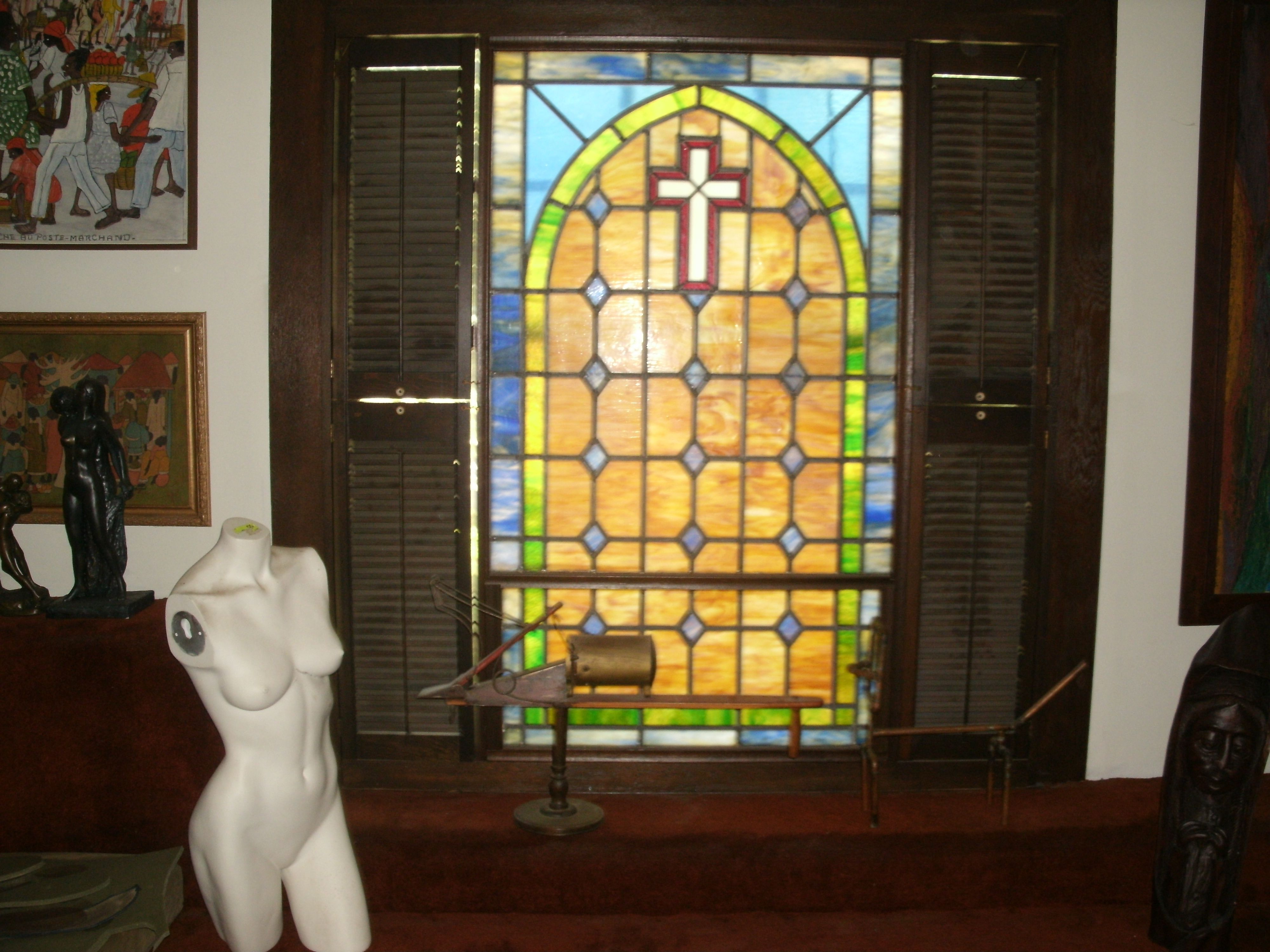 View of living room on south side showing large stained glass window ...