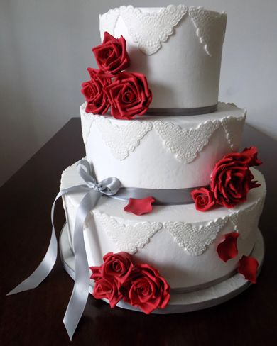 3 Tier buttercream wedding cake, decorated with silver ...