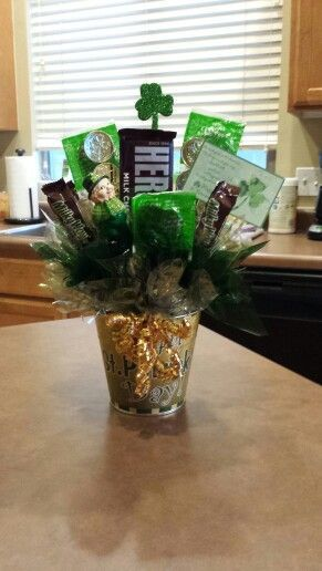 You have hit a gold mine - St Patricks Day candy centerpieces on this page will teach you how to make a candy bouquet! - http://sweetshotmemory.blogspot.com