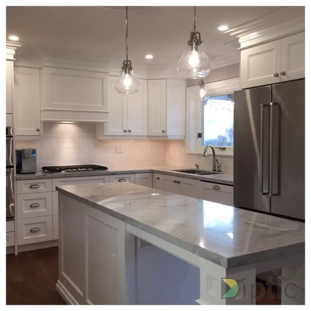 Prasada Kitchens And Fine Cabinetry: Transitional White Kitchen With Super White Countertops
