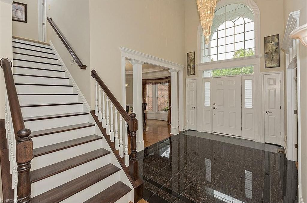 Traditional Entryway With High Ceiling Emerald Pearl Granite Tile Chandelier Slate Floors