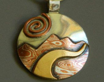 Mixed metal jewelry mokume gane silver by EvolveJewelryStudio