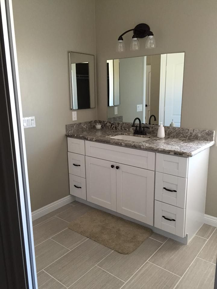 White shaker cabinets bianco antico granite countertops for White bathroom cabinets with bronze hardware