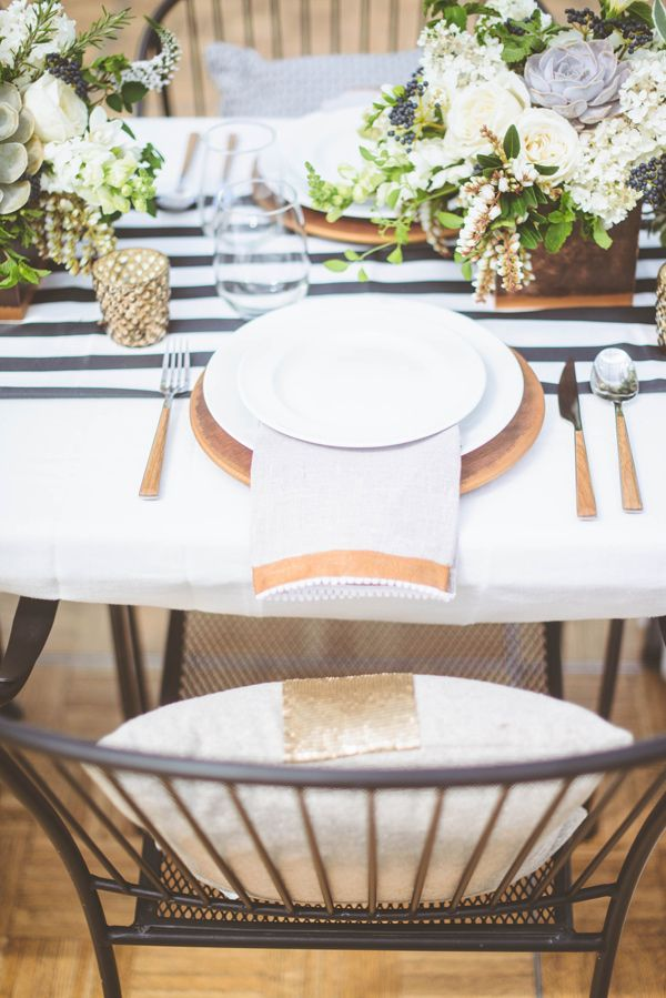 natural wood chargers // photo by Paper Antler, styling by Confetti Pop // http://ruffledblog.com/modern-nouveau-wedding-ideas