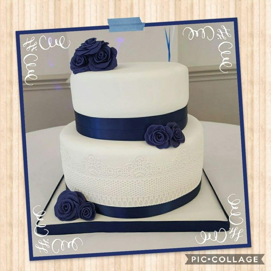 tier wedding cake with navy blue flowers and lace effect wedding