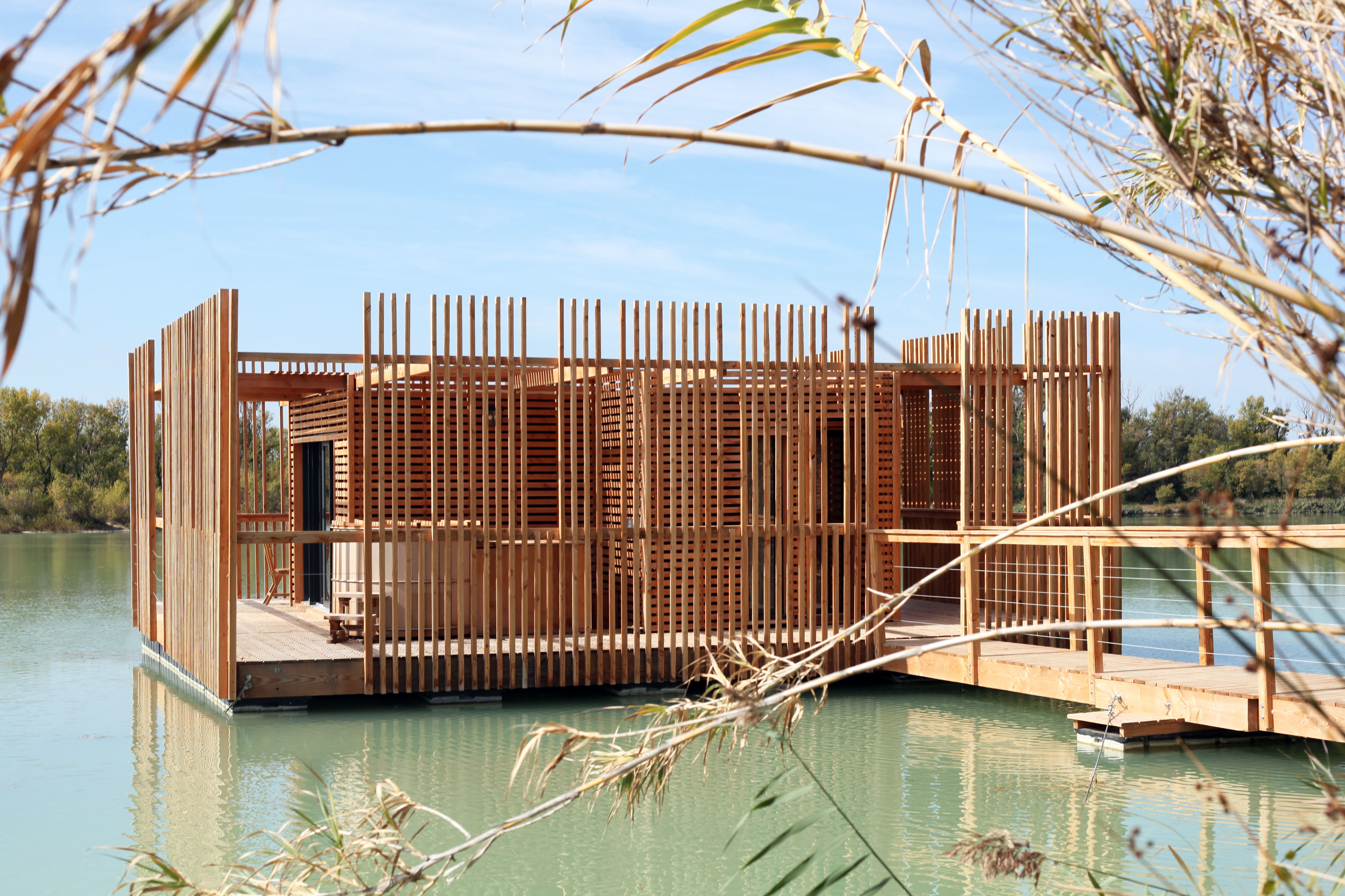 A View Of The Surrounding Wraparound Deck And Wooden Privacy Screens