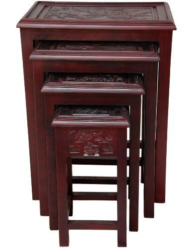 Set Of Four Nested Tables Finished In A Rich Cherry Wood Stain. Ming Era  Art Is Hand Carved Into Decorative Panels In The Center Of Each Table.