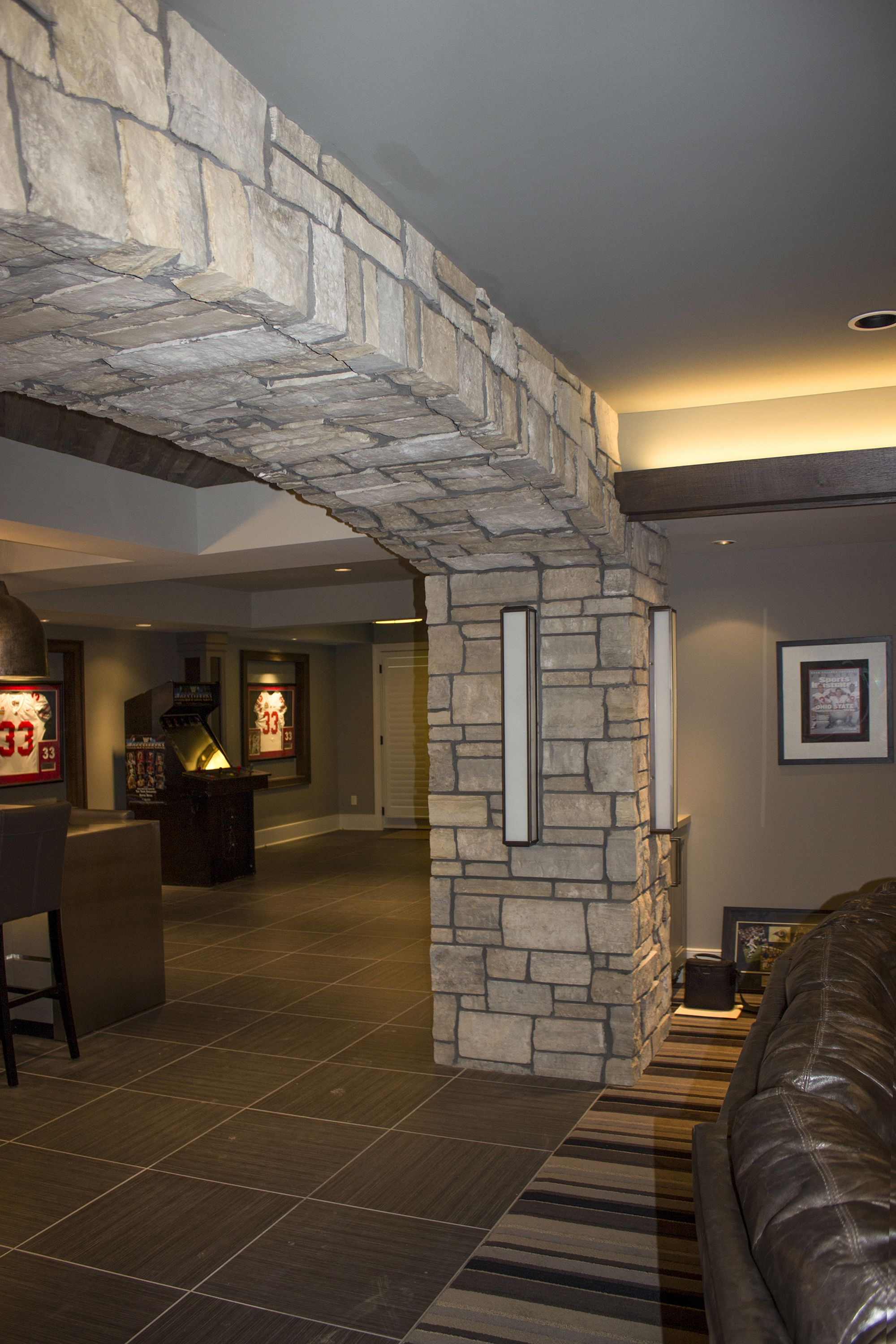 A Man Cave Featuring A Beautiful Stone Archway Of Harbour Blend Tumbled Ashlar Building Stone By Semco Stone Stone Archway Building Stone Stone Water Features