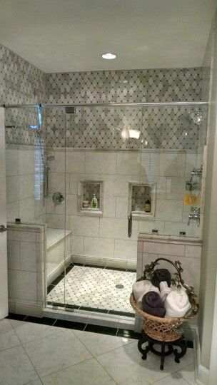 Master Bath Shower Enclosure - Carrara Marble tile wall and floor, glass wall and door, bench seat, double shower head designed by Will Calton at our Hoitt Avenue Kitchen and Bath showroom location Knoxville TN www.kitchensales.net