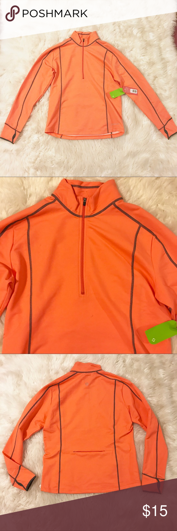 3/$30 🆕Women's running top moving comfort Brand new. Tags attached. Never worn.   Neon peach/nectar color with gray stitching. Pullover with a slight turtleneck. Zipper to make the top collared.   Stretchy material. Long sleeves with holes for thumbs for extra warmth. Small pocket at the lower back that zips.   Made of nylon, polyester, and Lycra  Retails for $65 Moving Comfort Sweaters