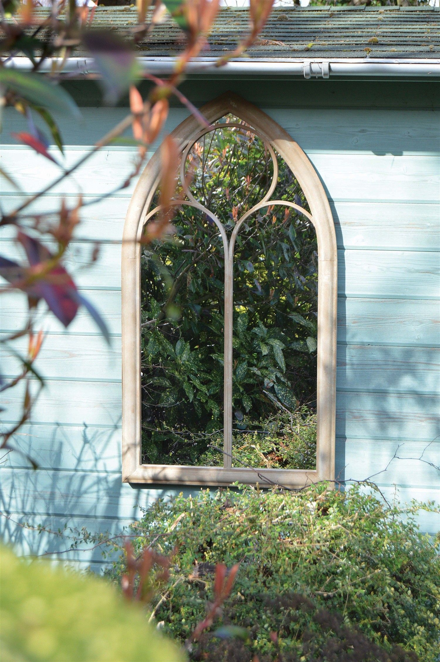 Growing Foliage Around A Garden Mirror Makes For A Great Feature