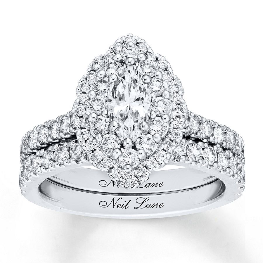 With a 1/2carat marquise diamond center and tightly