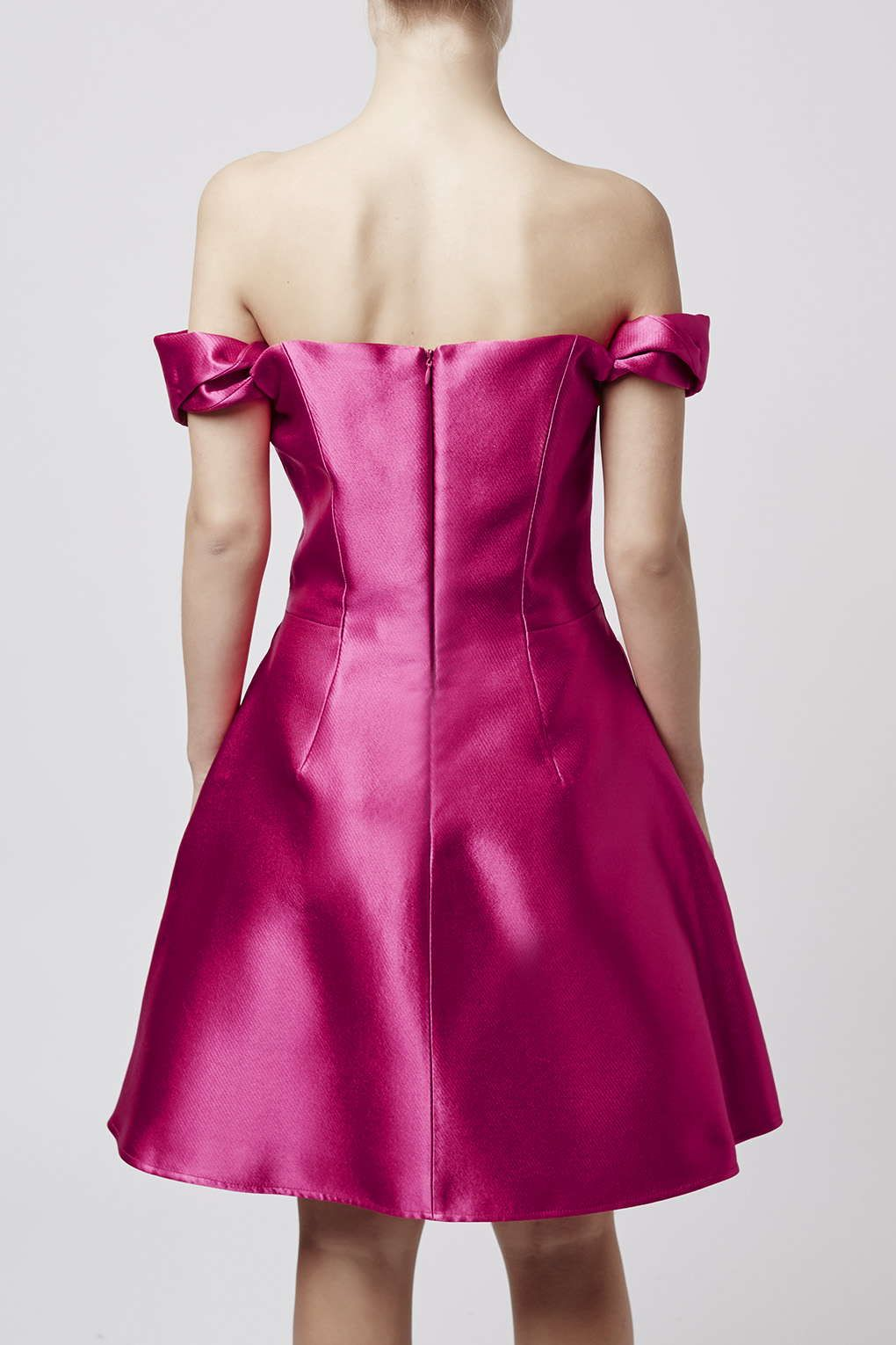 Shiny fabric in Fuschia makes our off shoulder dress the stand out party look of the season.