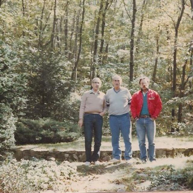 My grandfather in the middle w his brother on the left & other family member on the right