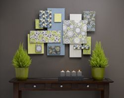 Cut sheets of foam, paint edges, glue on fabric or scrapbook paper, glue together in a cool pattern - awesome wall art.