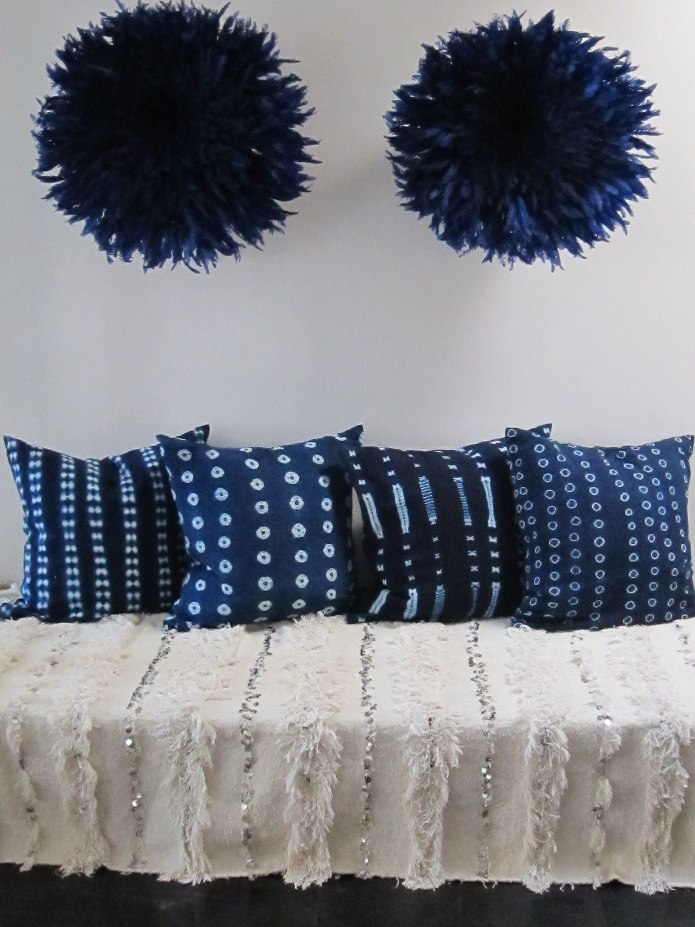 Hand-woven Mossi blanket from Burkino Faso, Indigo cushions and blue Juju hats from Cameroon