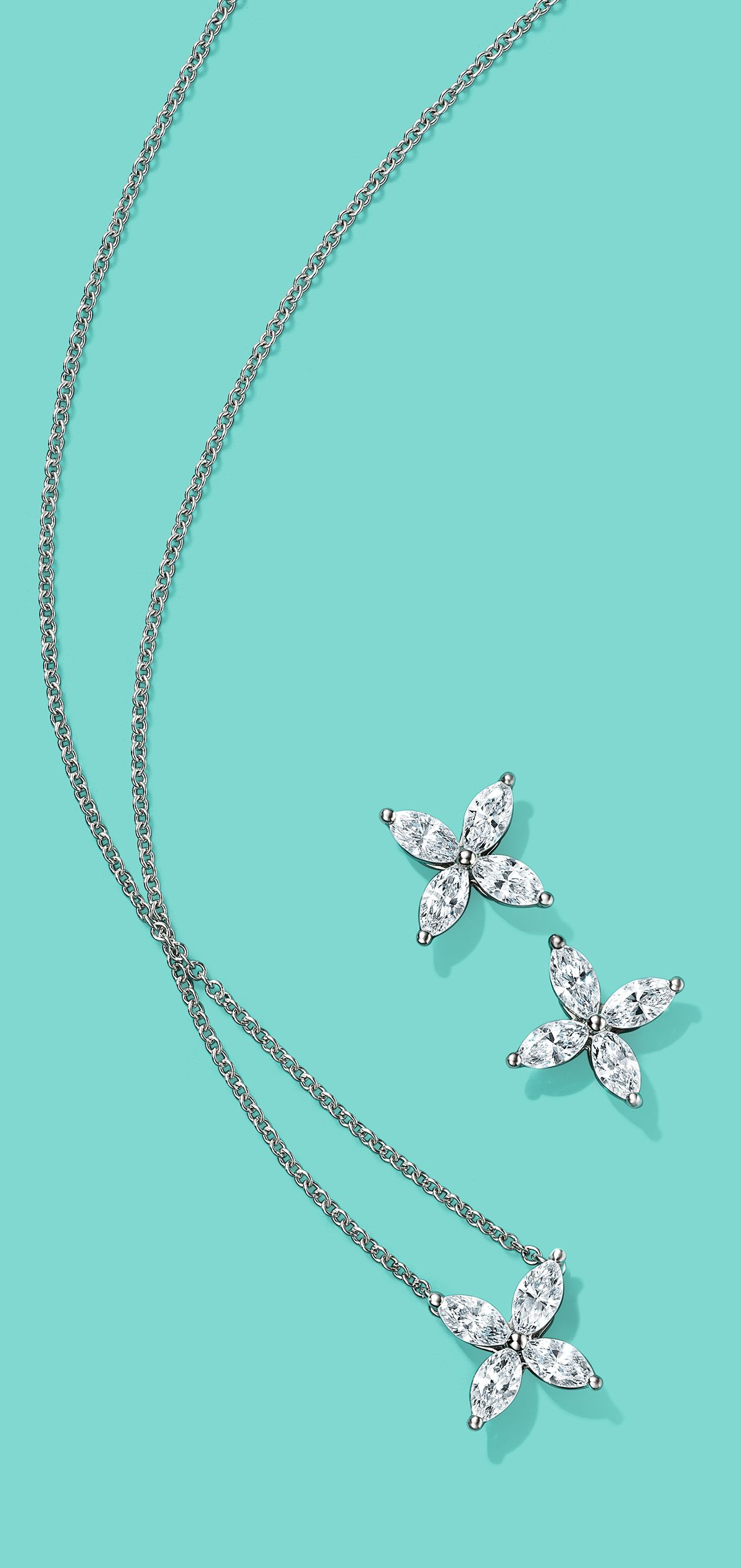 Let it snow. Tiffany Victoria® earrings and pendant in