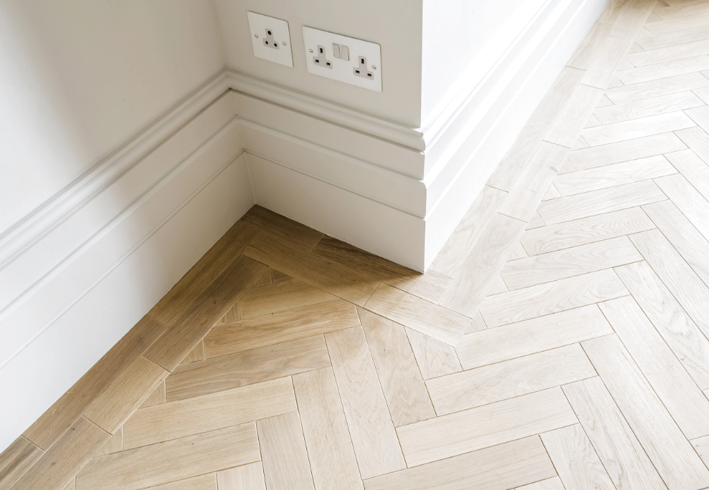 Herringbone wood floor with border to transition to living