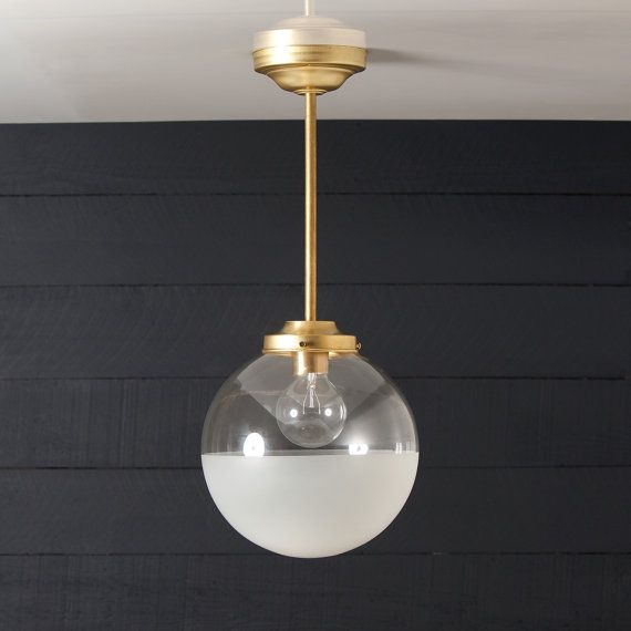 this brass pendant globe fixture features 10in wide half clear half frosted globe raw brass. Black Bedroom Furniture Sets. Home Design Ideas
