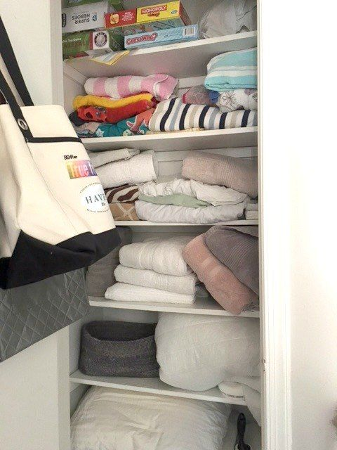 Pretty Linen Closet Organization