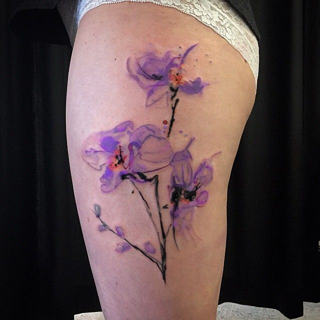 Watercolour Abstract Orchids On The Side Of The Thigh Tat Tats