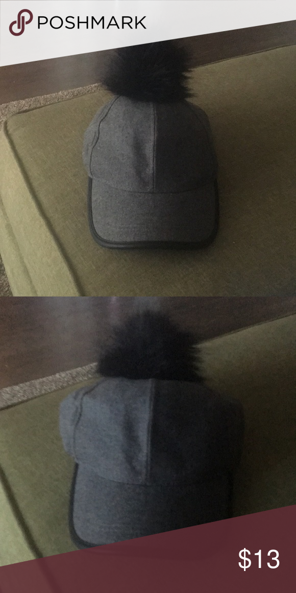 Rampage Baseball Cap with Fur Ball on Top. Gray Baseball Cap with Black  Faux Fur Ball on Top. The brim of the cap is trimmed with a faux leather. 598f5299203