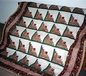 One Example Of A Log Cabin Quilt. Like This Pattern. Even The Colors Are