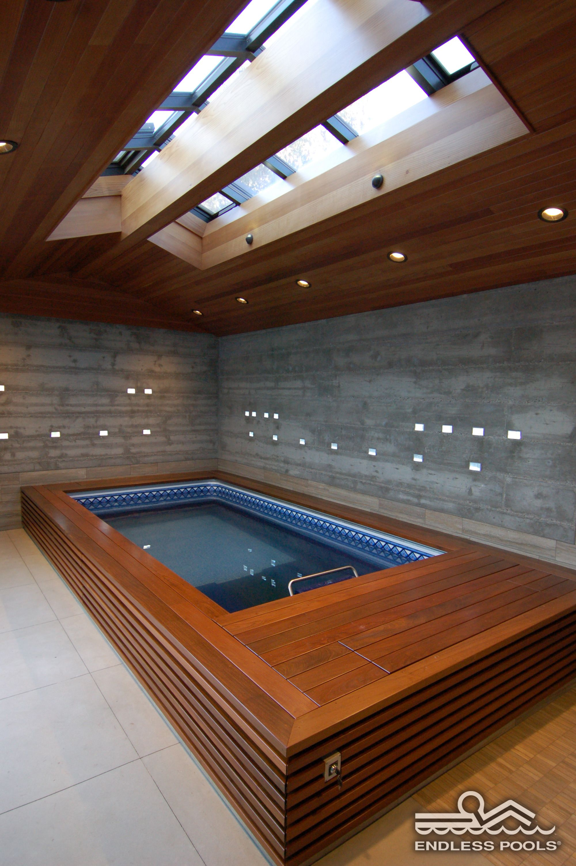 an indoor endless pool under bright skylights i also like that the deck on the. Interior Design Ideas. Home Design Ideas