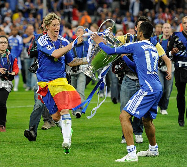 Fernando Torres Of Chelsea Passes The Trophy To Team Mate Jose Bosingwa 17 During Celebrations After UEFA Champions League Final Between FC Bayern
