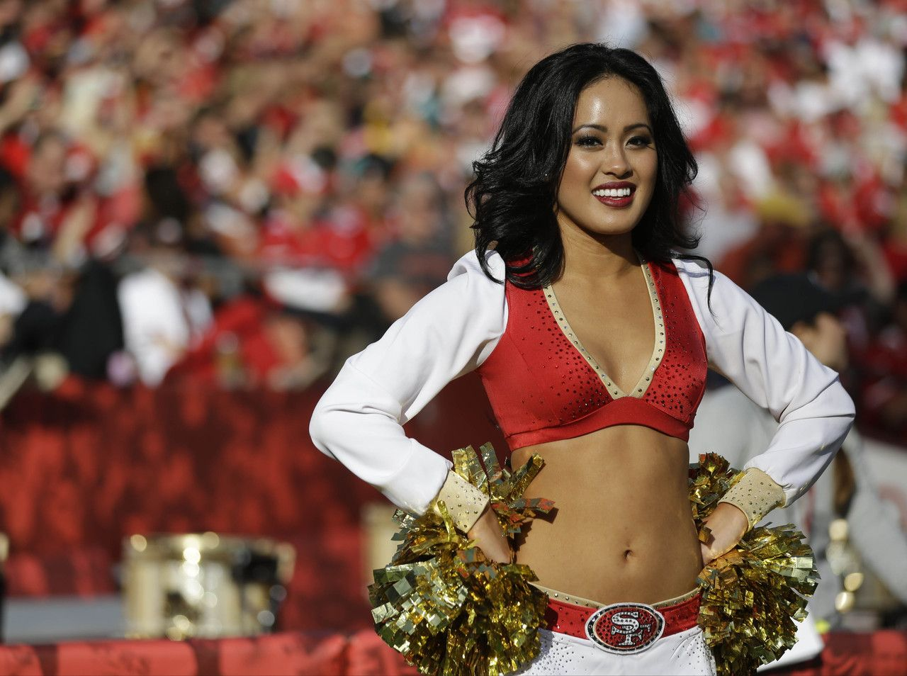 A San Francisco 49ers cheerleader performs during the second quarter of an NFL football game against the Miami Dolphins in San Francisco, Sunday, Dec. 9, 2012. (AP Photo/Marcio Jose Sanchez)