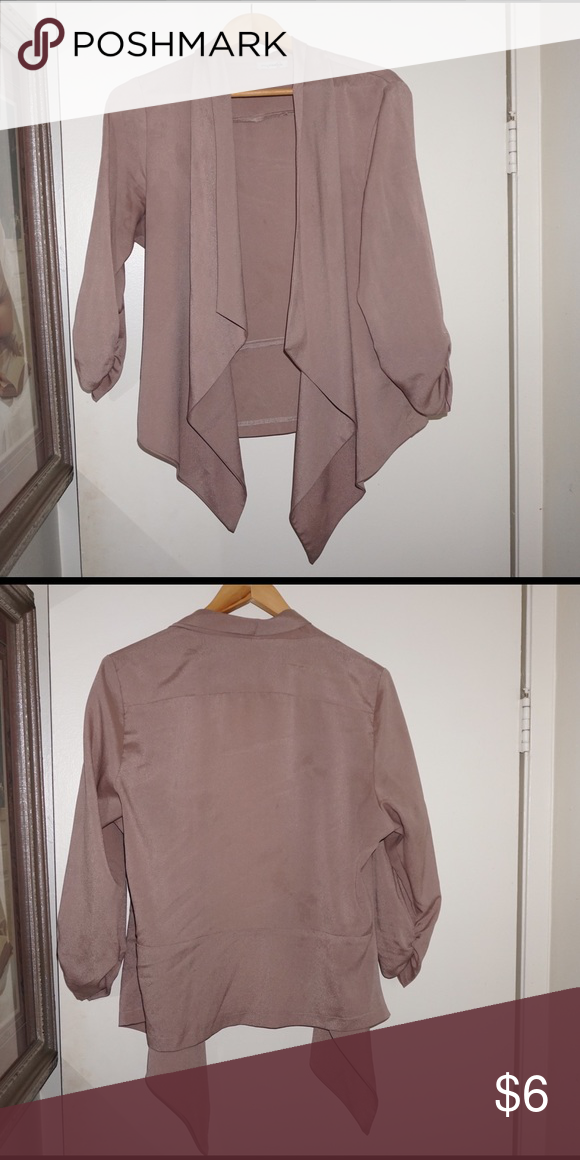 Silk throw on Silk material, has been worn many times but still in good condition. Fits someone who's L/XL Fashion Bug Tops Blouses