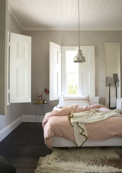 I enjoy both the color scheme- and the light directly over the bed